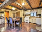 Step inside and enter the dining area and fully equipped kitchen.