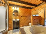 Enjoy the luxury of a Jacuzzi tub and pristine walk-in shower.