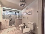 The bathroom also offer a spacious walk-in shower with 2 shower heads.