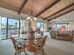 Marvel at the vaulted ceilings with exposed wood as you enter the spacious living area.