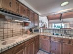 The kitchen offers plenty of counter space to make dinner for 2.