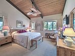 Head to the master bedroom to rest your head on the king-sized bed.