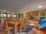 Gather around the dining table set for 6 while the wood-burning fireplace warms the room.