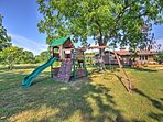 The property includes a large yard, swing set, grill, and fire pit.