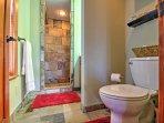 Primp and pamper in this private en-suite bathroom.