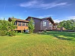 With 5 acres of land surrounding the property, you'll cherish this peaceful retreat.