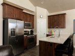 Kitchen with stainless steel appliances.  Top notch.