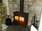 Multi fuel stove in inglenook fire place.
