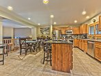 Fully Appointed Kitchen with Stainless Steel Appliances, 4-Burner Gas Stove, Granite Countertops, Bar Seating for 4 and...