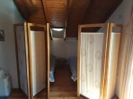 spare  room in loft, with folding door