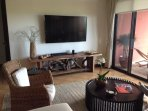 Living room boasts a 65 ' flat screen TV with extra HDMI cable for hooking up extra electronics !