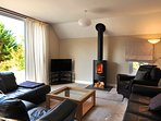 Lounge with wood burning stove and comfy sofas