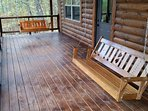 Relax and enjoy the view on one of the porch swings on the lower level deck.