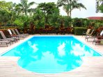 Take a refreshing dip in the pool or sit under the shade of the umbrellas.