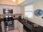 Full kitchen with granite countertops and stainless steel appliances