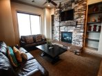 Living Area With Fireplace and Google TV