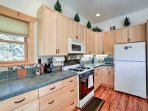 Cook with ease in the fully equipped kitchen.