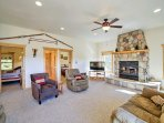 A cozy fireplace invites you to step inside and settle in for a relaxing stay.