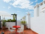 private roof terrace with chairs, table, deckchairs & outdoor shower