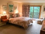 Master Bedroom with a King Bed and Balcony Access
