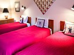 Fifth Bedroom Offers Three Twin Beds