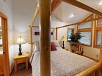 The attractive master bedroom suite (1) welcomes Guests with an appealing, queen-sized four-poster log pole pine bed