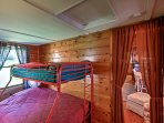 Cuddle up on the twin-over-full bunk bed.