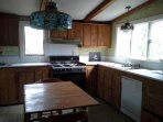 Kitchen w/ 6-burner gas stove