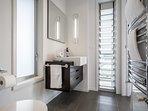 Stylish, full master bathroom.