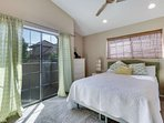 2nd bedroom features Queen bed, dresser, closet, small balcony and is located downstairs on the main floor