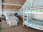 Full size bed in addition to bunk beds
