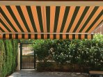 Private garden with awning.