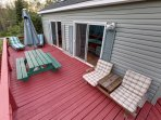 deck with lounge chairs, picnic table and barbecue