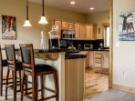 Additional kitchen bar seating to keep the cook company
