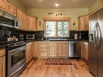 Sleek fully-equipped kitchen with stainless steel appliances