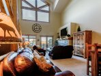 Vaulted ceilings and huge windows light up the home