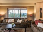 Cozy sofas and large windows that highlight slope views