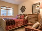 Second bedroom located on lower level with brand new Queen