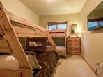 Third bedroom with two sets of bunks and flat screen TV