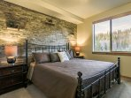 Master suite with stone accents
