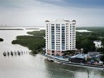 The 12th floor condo, (2nd from top) with panoramic floor to ceiling windows overlooks the beautiful bay, pass, and...