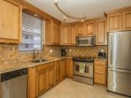 Beautiful, full kitchen, with stainless appliances, granite counters, upgraded cabinets, and all the cooking essentials.