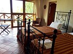 Bedroom with twin beds and expansive patio with stunning 180 degree views.