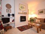Most comfortable sitting room with wall mounted flame effect fire, window seat, TV/DVD, Hifi, Wifi.