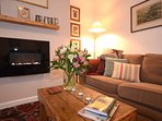 Sitting room detail. Magazines, local leaflets and maps are provided.