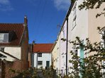 Mews Cottage is on the right; this is the view to the end of the mews into St Thomas Street, Wells.