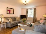 Lounge/diner looking towards front of the house. Large screen SMART TV. WiFi, local leaflets & maps.