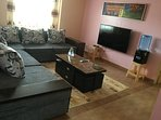 Comfortable living room with large Smart Tv and good WiFi