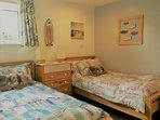 Twin bedroom: two full size adult single beds, drawers and wardrobe