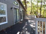 Enjoy the seasons on large front deck. One of four decks.